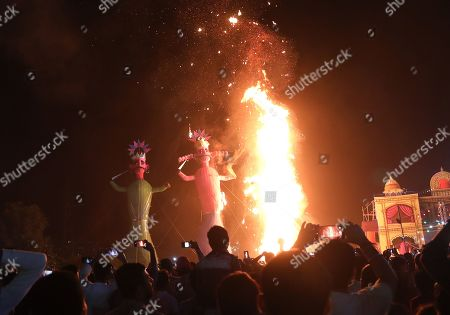 Stock Image of Effigies of demon king Ravana, Kumbhkarana and Meghnaad are set ablaze during Dussehra festival celebrations in the outskirts of Delhi, India, 08 October 2019. Dussehra is an annual Hindu religious festival which follows the nine day festival of Navratri and is celebrated as the victory of the mytholigical Hindu God Lord Rama over the evil demon king Ravana.