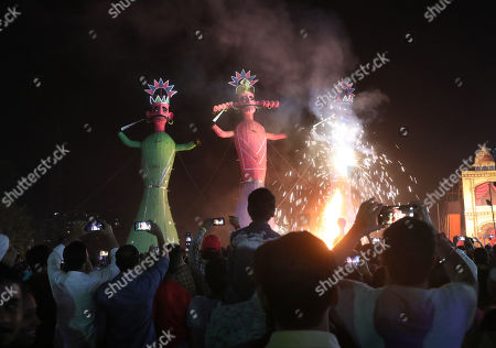 Stock Picture of Effigies of demon king Ravana, Kumbhkarana and Meghnaad are set ablaze during Dussehra festival celebrations in the outskirts of Delhi, India, 08 October 2019. Dussehra is an annual Hindu religious festival which follows the nine day festival of Navratri and is celebrated as the victory of the mytholigical Hindu God Lord Rama over the evil demon king Ravana.