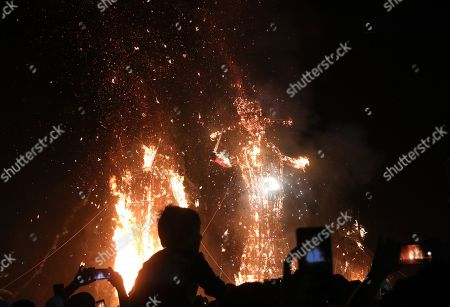 Effigies of demon king Ravana, Kumbhkarana and Meghnaad are set ablaze during Dussehra festival celebrations in the outskirts of Delhi, India, 08 October 2019. Dussehra is an annual Hindu religious festival which follows the nine day festival of Navratri and is celebrated as the victory of the mytholigical Hindu God Lord Rama over the evil demon king Ravana.