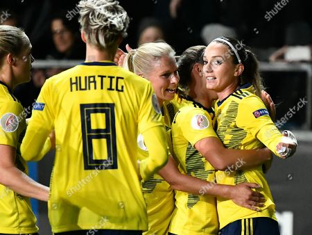 Sweden's Kosovare Asllani (R) celebrates with team mates after scoring the opening goal during UEFA women's EURO 2021 qualifying round group F between Sweden and Slovakia at Old Ullevi arena, Sweden, 8 October 2019.