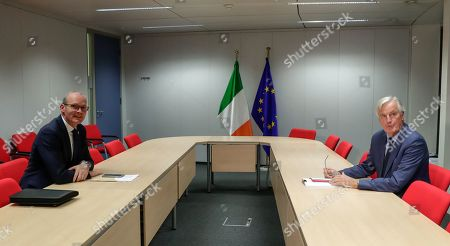 Irish Foreign Minister Simon Coveney (L) and European Union's chief Brexit negotiator Michel Barnier (R) sit for talks at the European Commission headquarters in Brussels, Belgium, 08 October 2019.
