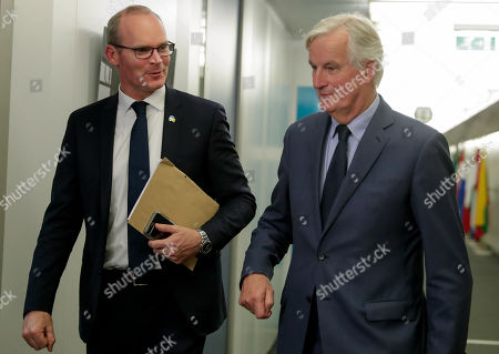 Irish Foreign Minister Simon Coveney is welcomed by European Union's chief Brexit negotiator Michel Barnier (R) ahead of talks at the European Commission headquarters in Brussels, Belgium, 08 October 2019.