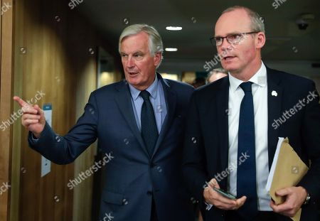 Stock Image of Irish Foreign Minister Simon Coveney is welcomed by European Union's chief Brexit negotiator Michel Barnier (L) ahead of talks at the European Commission headquarters in Brussels, Belgium, 08 October 2019.