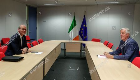 Stock Photo of Irish Foreign Minister Simon Coveney (L) and European Union's chief Brexit negotiator Michel Barnier (R) sit for talks at the European Commission headquarters in Brussels, Belgium, 08 October 2019.