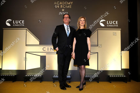 """David Rubin, president of the Film Academy, left, poses with CEO Dawn Hudson as they arrive for an event of the Academy of Motion Pictures, Arts and Sciences at Rome's Palazzo Barberini, . The Academy Museum of Motion Pictures has announced a partnership with Italy's Istituto Luce ? Cinecittà under which the state film entity will become a """"founding supporter"""" of the museum as part of a five-year agreement that will involve a series of annual events celebrating Italian cinema"""