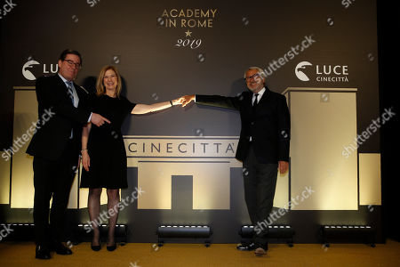 """From left, David Rubin, president of the Film Academy, CEO Dawn Hudson and Roberto Cicutto, Cinecitta Istituto Luce managing director arrive for an event of the Academy of Motion Pictures, Arts and Sciences at Rome's Palazzo Barberini, . The Academy Museum of Motion Pictures has announced a partnership with Italy's Istituto Luce ? Cinecittà under which the state film entity will become a """"founding supporter"""" of the museum as part of a five-year agreement that will involve a series of annual events celebrating Italian cinema"""