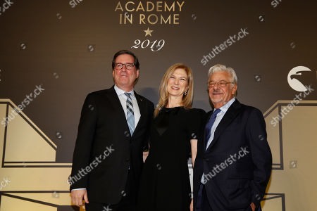"""Stock Photo of David Rubin, president of the Film Academy, left, and CEO Dawn Hudson, center, pose with actor Giancarlo Giannini as they arrive for an event of the Academy of Motion Pictures, Arts and Sciences at Rome's Palazzo Barberini, . The Academy Museum of Motion Pictures has announced a partnership with Italy's Istituto Luce ? Cinecittà under which the state film entity will become a """"founding supporter"""" of the museum as part of a five-year agreement that will involve a series of annual events celebrating Italian cinema"""