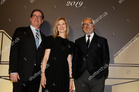 """From left, David Rubin, president of the Film Academy, CEO Dawn Hudson and Roberto Cicutto, Cinecitta Istituto Luce managing director pose for photographers as they arrive for an event of the Academy of Motion Pictures, Arts and Sciences at Rome's Palazzo Barberini, . The Academy Museum of Motion Pictures has announced a partnership with Italy's Istituto Luce ? Cinecittà under which the state film entity will become a """"founding supporter"""" of the museum as part of a five-year agreement that will involve a series of annual events celebrating Italian cinema"""
