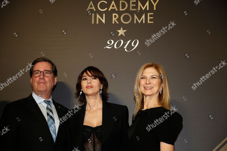 """From left, David Rubin, president of the Film Academy, actress Monica Bellucci and CEO Dawn Hudson pose for photographers as they arrive for an event of the Academy of Motion Pictures, Arts and Sciences at Rome's Palazzo Barberini, . The Academy Museum of Motion Pictures has announced a partnership with Italy's Istituto Luce ? Cinecittà under which the state film entity will become a """"founding supporter"""" of the museum as part of a five-year agreement that will involve a series of annual events celebrating Italian cinema"""