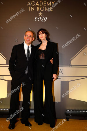 "Director Giuseppe Tornatore, left, and actress Monica Bellucci pose for photographers as they arrive for an event of the Academy of Motion Pictures, Arts and Sciences at Rome's Palazzo Barberini, . The Academy Museum of Motion Pictures has announced a partnership with Italy's Istituto Luce ? Cinecittà under which the state film entity will become a ""founding supporter"" of the museum as part of a five-year agreement that will involve a series of annual events celebrating Italian cinema"