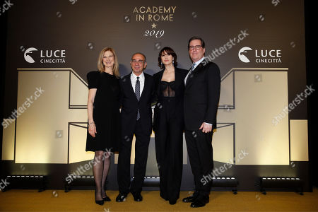 "From left, Film Academy CEO Dawn Hudson, director Giuseppe Tornatore, actress Monica Bellucci, and Film Academy President David Rubin, pose for photographers as they arrive for an event of the Academy of Motion Pictures, Arts and Sciences at Rome's Palazzo Barberini, . The Academy Museum of Motion Pictures has announced a partnership with Italy's Istituto Luce ? Cinecittà under which the state film entity will become a ""founding supporter"" of the museum as part of a five-year agreement that will involve a series of annual events celebrating Italian cinema"