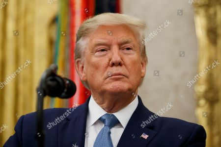 President Donald Trump pauses before speaking during a ceremony to present the Presidential Medal of Freedom to former Attorney General Edwin Meese, in the Oval Office of the White House, in Washington