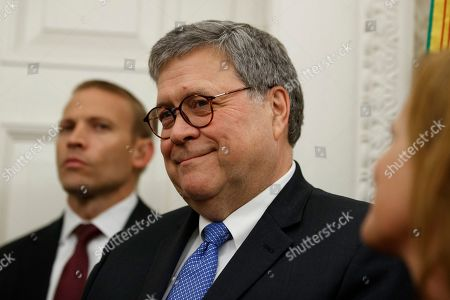 Attorney General William Barr, center, smiles during a ceremony to present the Presidential Medal of Freedom to former Attorney General Edwin Meese, in the Oval Office of the White House, in Washington