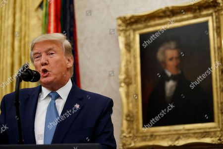 President Donald Trump speaks during a ceremony to present the Presidential Medal of Freedom to former Attorney General Edwin Meese, in the Oval Office of the White House, in Washington