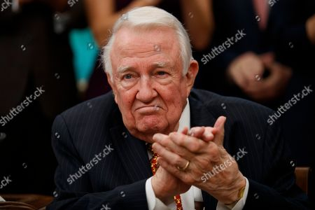 Former Attorney General Edwin Meese applauds as President Donald Trump speaks during a ceremony to present the Presidential Medal of Freedom to Meese, in the Oval Office of the White House, in Washington