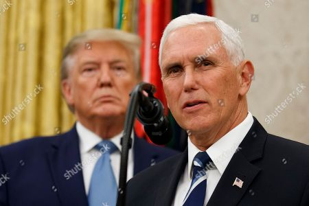 Donald Trump, Mike Pence. Vice President Mike Pence, right, speaks with President Donald Trump behind him, during a ceremony to present the Presidential Medal of Freedom to former Attorney General Edwin Meese, in the Oval Office of the White House, in Washington