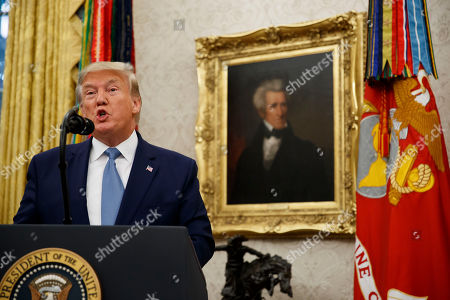 Stock Image of President Donald Trump speaks during a ceremony to present the Presidential Medal of Freedom to former Attorney General Edwin Meese, in the Oval Office of the White House, in Washington
