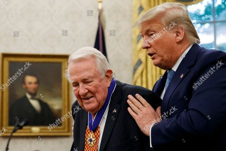 Donald Trump, Edwin Meese. President Donald Trump presents the Presidential Medal of Freedom to former Attorney General Edwin Meese, in the Oval Office of the White House, in Washington