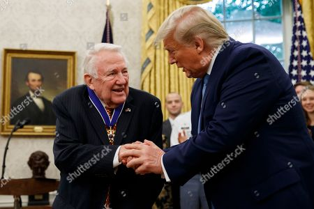 Donald Trump, Edwin Meese. President Donald Trump shakes hands with former Attorney General Edwin Meese after presenting him the Presidential Medal of Freedom, in the Oval Office of the White House, in Washington