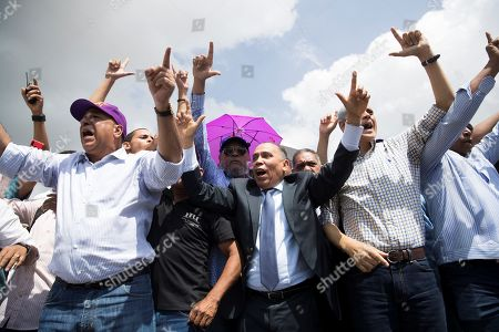 Leader Radhames Jimenez (C) speaks in front of supporters of former President and Presidential pre-candidate Leonel Fernandez who demonstrate against the results of primary elections held on 06 October, in front of the headquarters of the Central Electoral Board in Santo Domingo, Dominican Republic, 08 October 2019. Fernandez does not recognize the results of the PLD primaries, which was won by a narrow margin by former minister Gonzalo Castillo, elected candidate of the official formation for the May 2020 elections.