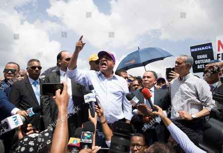 Leader Bautista Rojas speaks in front of supporters of former President and Presidential pre-candidate Leonel Fernandez who demonstrate against the results of primary elections held on 06 October, in front of the headquarters of the Central Electoral Board in Santo Domingo, Dominican Republic, 08 October 2019. Fernandez does not recognize the results of the PLD primaries, which was won by a narrow margin by former minister Gonzalo Castillo, elected candidate of the official formation for the May 2020 elections.