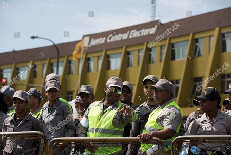 Policemen guard as supporters of former President and Presidential pre-candidate Leonel Fernandez demonstrate against the results of primary elections held on 06 October, in front of the headquarters of the Central Electoral Board in Santo Domingo, Dominican Republic, 08 October 2019. Fernandez does not recognize the results of the PLD primaries, which was won by a narrow margin by former minister Gonzalo Castillo, elected candidate of the official formation for the May 2020 elections.