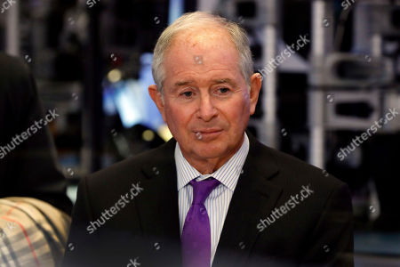 Stephen Schwarzman, chairman, CEO and co-founder of the investment firm Blackstone, waits to be interviewed on the floor of the New York Stock Exchange