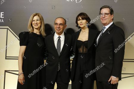 Stock Picture of President of the Film Academy David Rubin (R), Italian actress Monica Bellucci (2-R), CEO of Film Academy Dawn Hudson (L) and Italian director Giuseppe Tornatore pose on the red carpet at the first Italian event of the 'Academy of Motion Pictures, Arts and Sciences' at Barberini Palace in Rome, Italy, 08 October 2019.