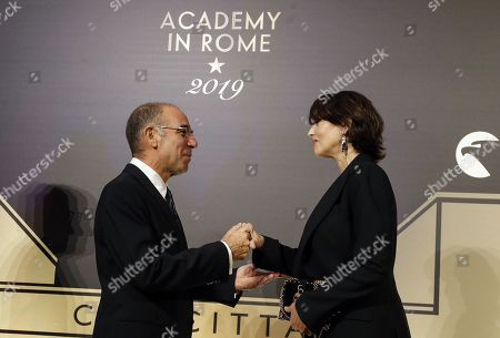 Giuseppe Tornatore (L) and Italian actress Monica Bellucci pose on the red carpet at the first Italian event of the 'Academy of Motion Pictures, Arts and Sciences' at Barberini Palace in Rome, Italy, 08 October 2019.
