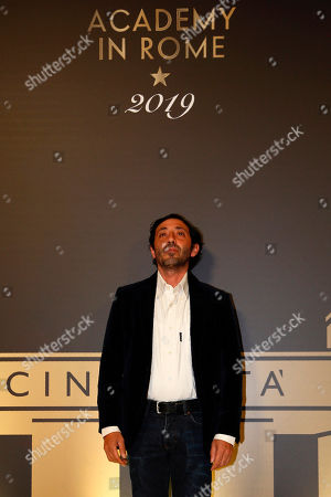 """Stock Image of Actor Marcello Fonte poses for photographers as she arrives for an event of the Academy of Motion Pictures, Arts and Sciences at Rome's Palazzo Barberini, . The Academy Museum of Motion Pictures has announced a partnership with Italy's Istituto Luce ? Cinecittà under which the state film entity will become a """"founding supporter"""" of the museum as part of a five-year agreement that will involve a series of annual events celebrating Italian cinema"""