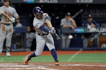 Houston Astros' Jose Altuve singles in the fourth inning against the Tampa Bay Rays in Game 4 of a baseball American League Division Series, in St. Petersburg, Fla
