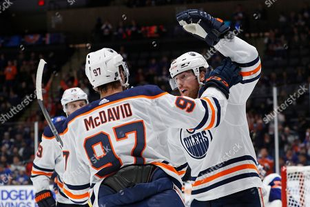 James Neal, Connor McDavid, Leon Draisaitl. Edmonton Oilers left wing James Neal, right, celebrates with center Connor McDavid (97) after scoring a goal during the first period of the team's NHL hockey game against the New York Islanders, in Uniondale, N.Y. Oilers center Leon Draisaitl is at back left