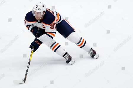 Edmonton Oilers center Connor McDavid skates with the puck during the third period of the team's NHL hockey game against the New York Islanders, in Uniondale, N.Y
