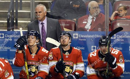 Florida Panthers head coach Joel Quenneville looks on against the Carolina Panthers during the third period of an NHL hockey game, in Sunrise, Fla