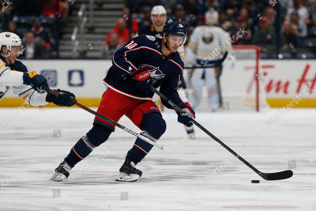 Columbus Blue Jackets forward Alexander Wennberg, right, of Sweden, carries the puck against Buffalo Sabres forward Jeff Skinner during an NHL hockey game in Columbus, Ohio, . The Blue Jackets won 4-3 in overtime