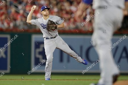 Los Angeles Dodgers shortstop Corey Seager throws out Washington Nationals' Trea Turner at first base during the third inning of Game 3 of a baseball National League Division Series, in Washington