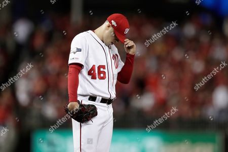 Washington Nationals pitcher Patrick Corbin reacts after allowing a double to Los Angeles Dodgers' Enrique Hernandez during the sixth inning of Game 3 of a baseball National League Division Series, in Washington