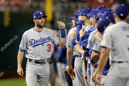 Los Angeles Dodgers left fielder Chris Taylor greets teammates during introductions prior to Game 3 of a baseball National League Division Series against the Washington Nationals, in Washington