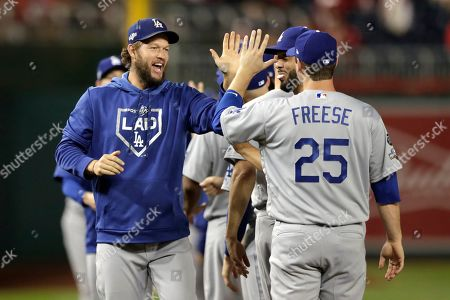 Los Angeles Dodgers starting pitcher Clayton Kershaw greets teammates during introductions prior to Game 3 of a baseball National League Division Series against the Washington Nationals, in Washington