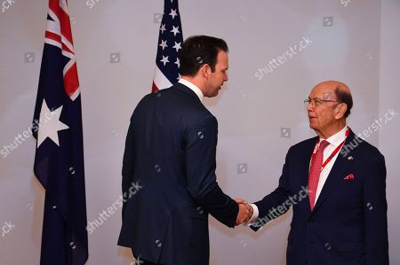 Australian Resource Minister Matt Canavan (L) shakes hands with US Secretary of Commerce Wilbur Ross (R) during a meeting held to discuss the Australia-US Partnership on Critical Minerals at Parliament House in Canberra, Australia, 09 October 2019.