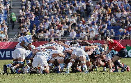 Felipe Ezcurra of Argentina (L) feeds the ball into the scrum as referee Paul Williams (R) officiates during the Rugby World Cup match between Argentina and the USA at Kumagaya Rugby Stadium in Tokyo, Japan, 09 October 2019.
