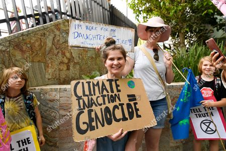Stock Picture of Activists participate in an Extinction Rebellion protest outside 1 William Street where Queensland Premier Annastacia Palaszczuk and Minister for Police Mark Ryan were making a statement in Brisbane, Queensland, Australia, 09 October 2019. The Extinction Rebellion (XR) climate protests movement has planned a 'spring rebellion' from 07 to 13 October 2019, including marches aimed at blocking traffic.