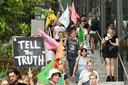 Stock Image of Activists participate in an Extinction Rebellion protest outside 1 William Street where Queensland Premier Annastacia Palaszczuk and Minister for Police Mark Ryan were making a statement in Brisbane, Queensland, Australia, 09 October 2019. The Extinction Rebellion (XR) climate protests movement has planned a 'spring rebellion' from 07 to 13 October 2019, including marches aimed at blocking traffic.
