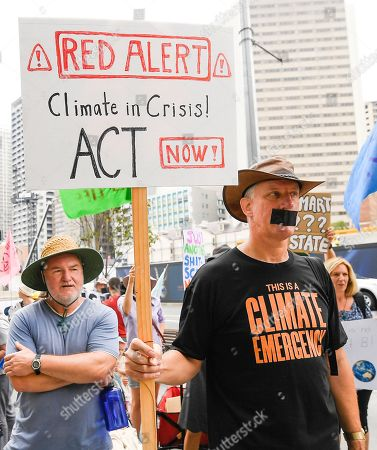 Activists participate in an Extinction Rebellion protest outside 1 William Street where Queensland Premier Annastacia Palaszczuk and Minister for Police Mark Ryan were making a statement in Brisbane, Queensland, Australia, 09 October 2019. The Extinction Rebellion (XR) climate protests movement has planned a 'spring rebellion' from 07 to 13 October 2019, including marches aimed at blocking traffic.