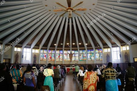 On, members of the Restoration Centre Church celebrate Mass in the Nairobi suburb of Karen, Kenya, on Sunday, June 17, 2019