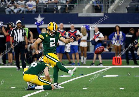 J.K. Scott, Mason Crosby. Green Bay Packers' J.K. Scott (6) holds as kicker Mason Crosby (2) attempt a score during an NFL football game against the Dallas Cowboys in Arlington, Texas