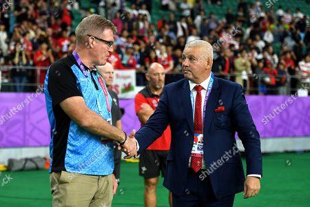 Fiji head coach John McKee and Wales head coach Warren Gatland at the end of the game.