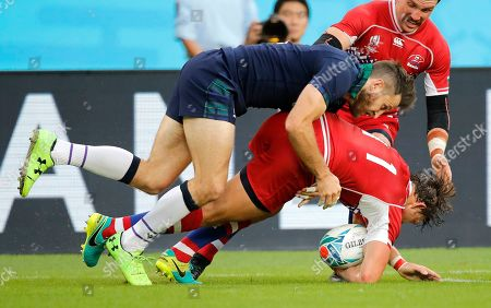 Scotland's Tommy Seymour tackled Russia's Vladislav Sozonov during the Rugby World Cup Pool A game at Shizuoka Stadium Ecopa between Scotland and Russia in Shizuoka, Japan