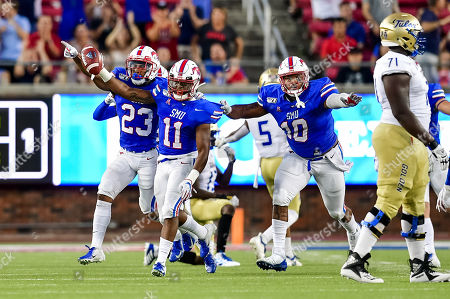 Southern Methodist Mustangs cornerback Chevin Calloway (11) recovers a fumble as Southern Methodist Mustangs defensive tackle Demerick Gary (10) and Southern Methodist Mustangs safety Rodney Clemons (23) during an NCAA Football game between the Tulsa Golden Hurricanes and SMU Mustangs at the Gerald J. Ford Stadium in Dallas, Texas, Oct. 5th, 2019