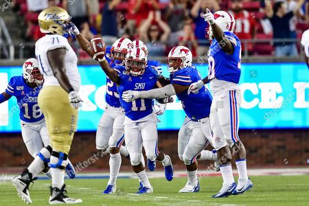 Stock Picture of Southern Methodist Mustangs cornerback Chevin Calloway (11) recovers a fumble as teammates celebrate during an NCAA Football game between the Tulsa Golden Hurricanes and SMU Mustangs at the Gerald J. Ford Stadium in Dallas, Texas, Oct. 5th, 2019